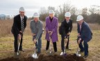 Picture of several people holding shovels with dirt at the groundbreaking of Life Time Beaverton
