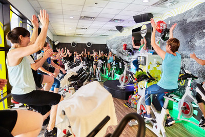 Spin4Kids participants at GoodLife Fitness Stittsville Corners in Stittsville, ON, take part in the annual fitness fundraiser that raised over $900,000 nationwide for kids with autism and intellectual disabilities. (CNW Group/GoodLife Kids Foundation)