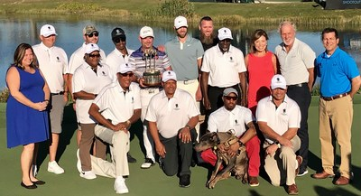 Fourteen Wounded Warrior Project® (WWP) warriors and their guests, attended the QBE Shootout at Tiburon Golf Club in Naples, Florida recently. Kevin Tway and Rory Sabbatini (center, with trophy) won the tournament.