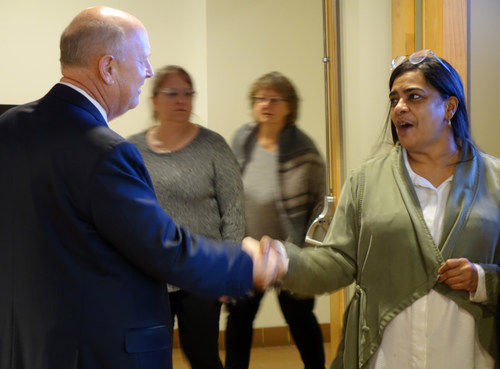Andersen Corporation Chairman and CEO Jay Lund thanks customer service representative, Dawn Ampey, during one of Andersen's 2019 profit sharing celebrations.
