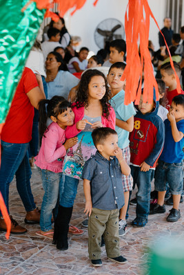 Migrant children in Matamoros, Mexico, line up to participate in a Posada procession sponsored by the Knights of Columbus. The Posada is  a Christmas tradition in Mexico that recalls the pilgrimage of Mary and Joseph to Bethlehem for the birth of Jesus. The Knights were also on hand to donate food, clothing and medical and other supplies to a home for migrants sponsored by the Catholic Diocese of Matamoros.