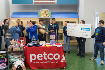 Winning adopter and school shooting survivor Drew Pescaro and his dog Lilly celebrate a $50,000 grant award with the team from Peak Lab Rescue.