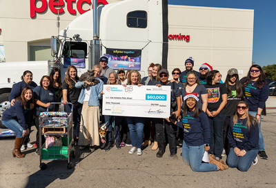 The team from San Antonio Pets Alive celebrate their $60,000 Holiday Wishes grant award from the Petco Foundation with winning adopters Beverley Oaks and Florencia Aguilar.