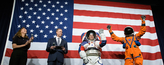 NASA spacesuit engineer Amy Ross and NASA Administrator Jim Bridenstine introduce spacesuit engineer Kristine Davis, wearing a ground prototype of NASA's new Exploration Extravehicular Mobility Unit (xEMU), and Orion Crew Survival Systems Project Manager Dustin Gohmert, wearing the Orion Crew Survival System suit, Oct. 15, 2019 at NASA Headquarters in Washington. Credit: NASA