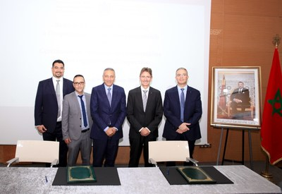 From Left to Right: Mr. Fares Naouri (Global Manager Government Inspections & International Trade - TUV Rheinland); Mr. Mohamed Alikkane (Managing Director - TUV Rheinland Morocco), H.E. Moulay Hafid Elalamy (The Minister of Industry, Trade, Green and Digital Economy), Mr. Andreas Hofer (Regional Executive Vice President India, Middle East, Africa & Asia Pacific - TUV Rheinland) & Mr. Tarek Khelifi (Managing Director - TUV Rheinland Tunisia).