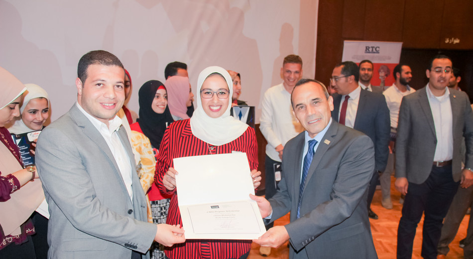 Left to right: Mostafa Araby - Founder of the CMA teaching program at Resala and Senior Financial Analyst at General Motors Egypt, Omnia Ezz - an accountant and Resala student receiving her CMA scholarship and Ahmad Mkhallati - IMA Director of Regional Partner Relationships