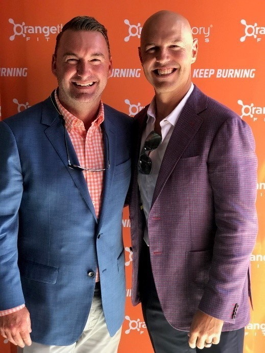 (Left to Right) Jamie Weeks, President and CEO of Honors Holdings and Dave Long, co-founder and CEO of Orangetheory Fitness at Orangetheory Fitness' 1,000th studio opening - an Honors owned studio in Portland, Oregon.