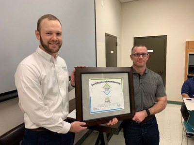 SUEZ Water Idaho Vice President Marshall Thompson, right, receives a plaque from Josh Blount, DIPRA Regional Engineer, welcoming the water utility to DIPRA's Century Club, which recognizes utilities that have iron pipes in service for more than 100 years.