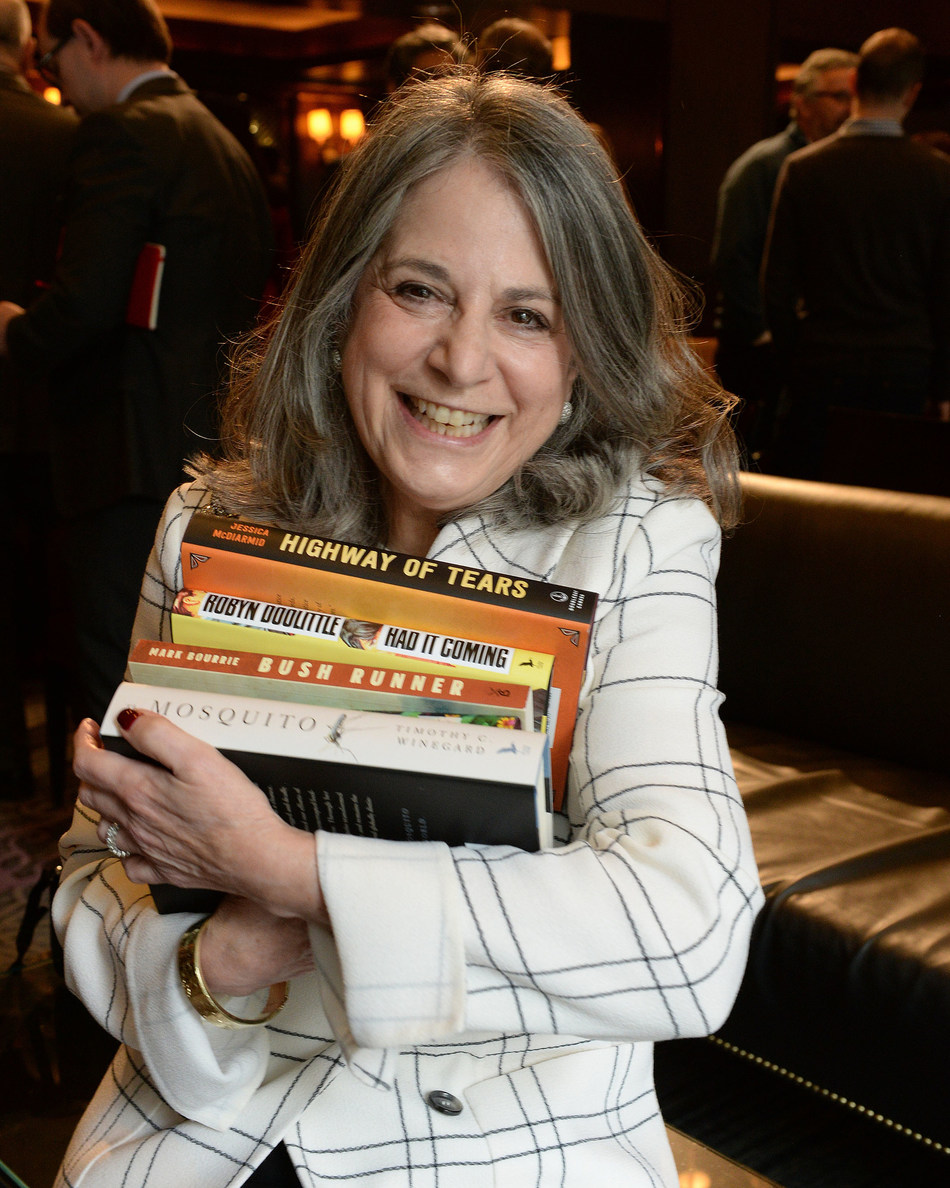 Noreen Taylor, founder of the RBC Taylor Prize, shows of the five short listed literary non-fiction books up for the 2020 RBC Taylor Prize.   PHOTO TOM SANDLER (CNW Group/RBC Taylor Prize)