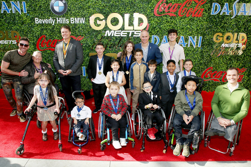 The children and para-atheltes of Angel City Sports, the official beneficiary of Gold Meets Golden, presented by Coca-Cola, BMW Beverly Hills and FASHWIRE.