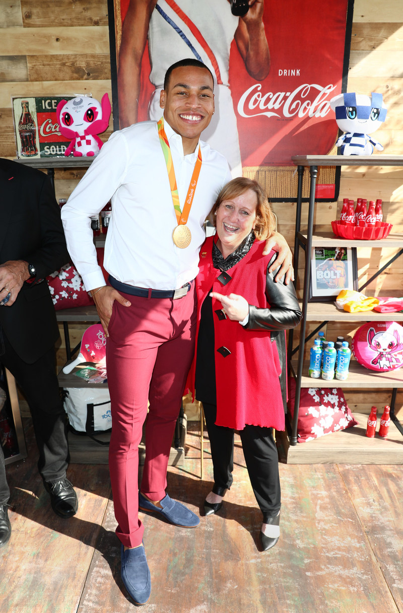 Paralympian Roderick Townsend with Dina Gerson of Coca-Cola at the Coca-Cola Tokyo-themed Bodega, Gold Meets Golden 2020.