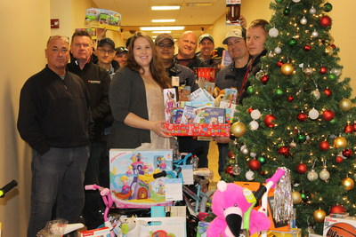 Volunteers with some of the donated toys.