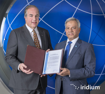 Iridium CEO Matt Desch receives the Letter of Compliance for Iridium to provide GMDSS services from Captain Moin Ahmed, Director General of the International Mobile Satellite Organization.
