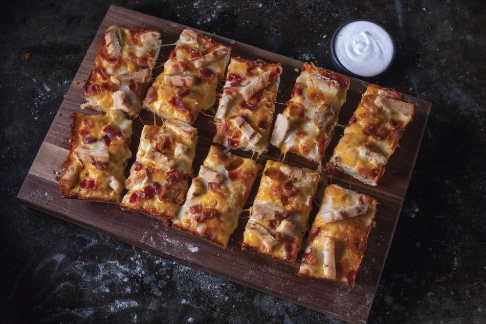 Jet's Chicken Bacon Ranch Detroit-style Pizza. Loaded with chicken, Jet's ranch, bacon, premium mozzarella, and cheddar cheese.