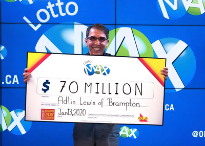 Adlin Lewis of Brampton accepts his $70 million cheque at the OLG Prize Centre in Toronto. Adlin won the record-breaking jackpot in the Tuesday, January 7, 2020 LOTTO MAX draw. (CNW Group/OLG Winners)