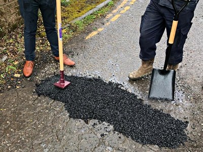 A quick, permanent repair made with EZ Street Asphalt. Oneof the comments often heard from asphalt pros is how much the product resembleshot asphalt in handling and performance.