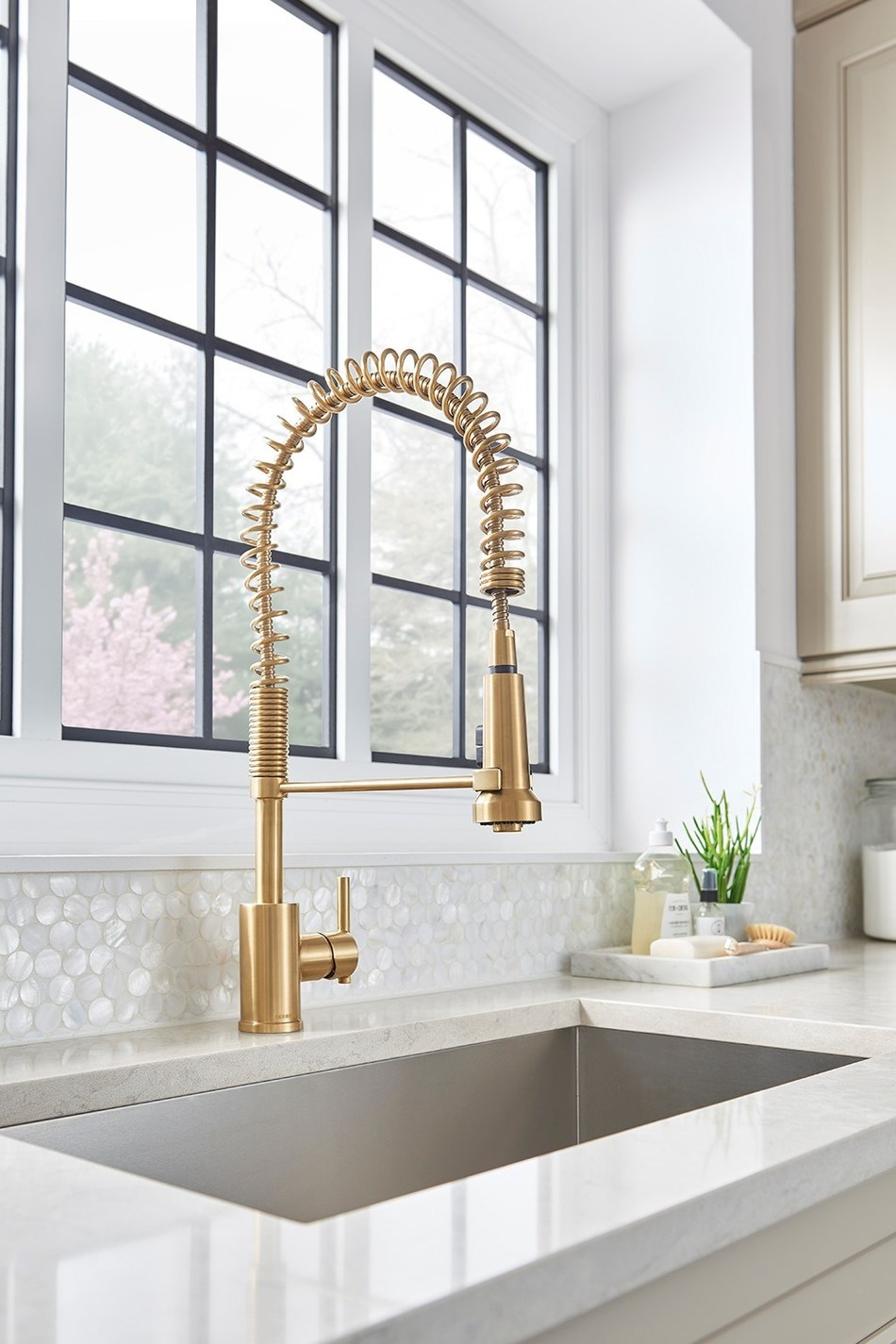 Gerber® Parma® Pre-Rinse Kitchen Faucet in Brushed Bronze.