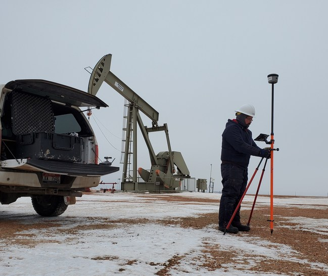 EcoPoint technician capturing flowline location data using geospatial recording devices.