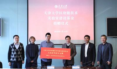 Jiajun Li, accepts the donation from Hoopox