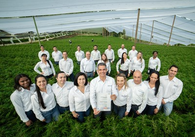Marcelo Antunes de Siqueira Head of agricultural operations with some of the 450 PharmaCielo employees and first issued medicinal cannabis GAP Certificate at facilities in Rionegro, Colombia. (CNW Group/PharmaCielo Ltd.)