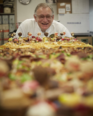 Certified Master Chef Ron DeSantis looks upon the Hormel Foods 54 topping pizza.
