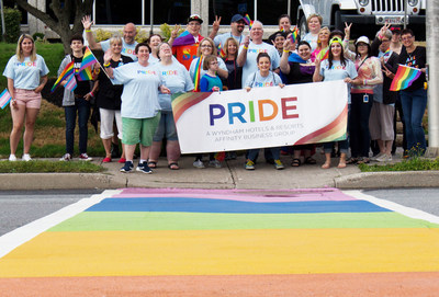 Wyndham Hotels & Resorts team members in Saint John, New Brunswick, Canada, support the local LGBTQ community through participating in a Pride march and painting a crosswalk outside of the Saint John office (August 2019).