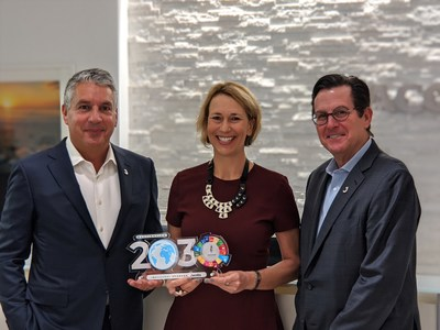 L-R, Jacobs Chair and CEO Steve Demetriou, Water For People CEO Eleanor Allen and Jacobs President and CFO Kevin Berryman commemorate Jacobs' inaugural sponsor contribution to Water For People's Destination 2030 initiative.