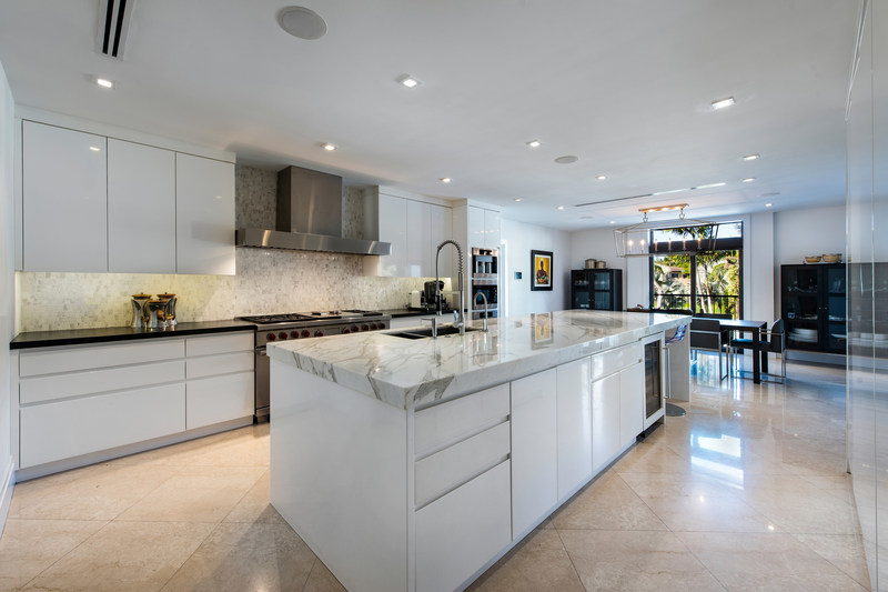 The kitchen, with a clean and elegant aesthetic, was designed with the help of a gourmet chef, and offers a robust suite of appliances by Miele, Sub-Zero and Wolf. The oversized island was custom-built from just two slabs of Calacatta marble. MiamiLuxuryAuction.com.