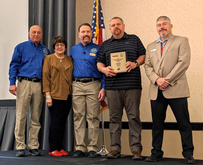 Spartan Motors and Firehouse magazine present the EVT of the Year Award at the FDSOA Fire Safety Conference. Left to Right: Rich Marinucci, Executive Director, FDSOA; Janet Wilmoth, Special Projects Director, Firehouse; Eric Valliere, Chairman, FDSOA; Brian Marek, EVT of the Year Award winner; and Jeff Seal, OEM Account Manager, Spartan Motors.