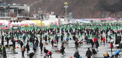 Visitors enjoy ice fishing at the 2020 Hwacheon Sancheoneo Ice Festival in Hwacheon, Gangwon Province, on Jan. 27, 2020. (PRNewsfoto/Hwacheon County)