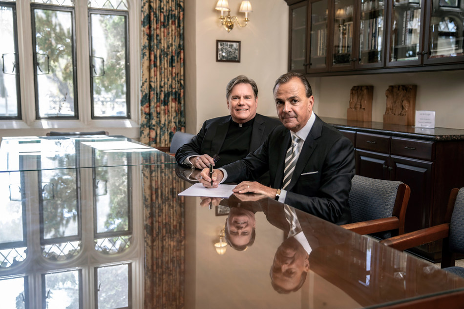 Loyola High School of Los Angeles President Fr. Gregory M. Goethals, SJ '73 (left) and Loyola Board Chair, business innovator, civic leader and philanthropist Rick J. Caruso (right) at the signing of Mr. Caruso and his wife Tina Caruso's $5 million gift to the Jesuit preparatory school.