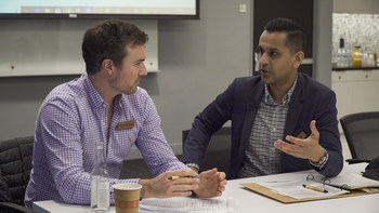 Chipotle executive Haris Khan advising Alexander McCoy, Founder and CEO of American Ostrich Farms, during the 2019 Chipotle Aluminaries bootcamp