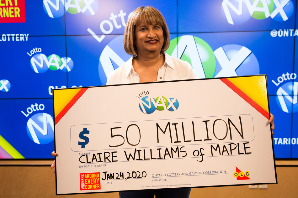 Claire Williams of Maple accepts her $50 million cheque at the OLG Prize Centre in Toronto. Claire won the Friday, January 17, 2020 LOTTO MAX jackpot. (CNW Group/OLG Winners)