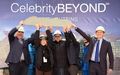 Royal Caribbean Cruises Ltd. and Chantiers de l'Atlantique executives raising the signed commemorative ship cut-out at the ceremonial steel-cutting for Celebrity Beyond, coming fall 2021. (From left to right: Richard D. Fain, Chairman and CEO, RCCL; Lisa Lutoff-Perlo, President and CEO, Celebrity Cruises; Harri Kulovaara, Executive Vice President, Maritime and Newbuilding, RCCL; and Laurent Castaing, General Manager, Chantiers de l'Atlantique)