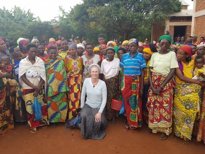 The women's cooperative of the nearby village of Mubuga will benefit from productive uses of solar power as part of a social and economic development program.  Dr. Hanna Klein (center), VP of Research and Project Development of Gigawatt Global, holds a PhD from the Weizmann Institute of Science in solar energy and is planning to switch the village flour mills from diesel to solar-powered electric motors. (PRNewsfoto/Gigawatt Global)