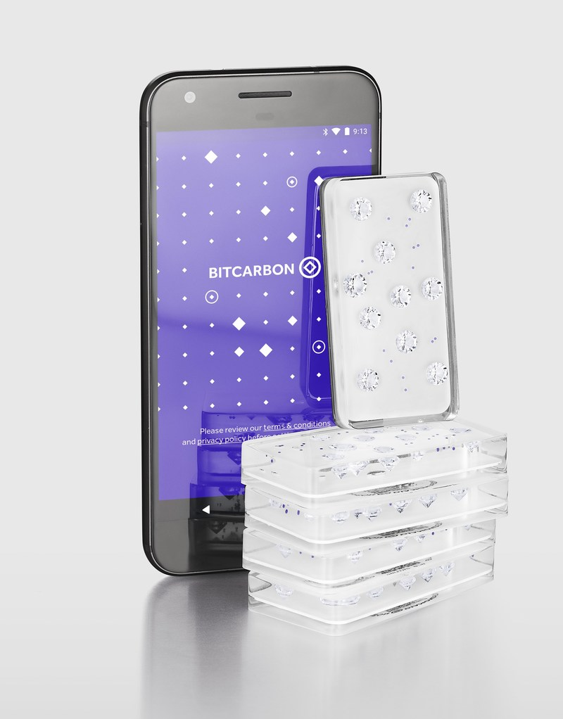 $500,000 worth of Diamond Standard Bars, the first regulator-approved standardized diamond commodity, shown with a smartphone application used for authentication and blockchain transactions.