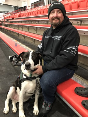 Veteran, Michael Pais and his dog Gator