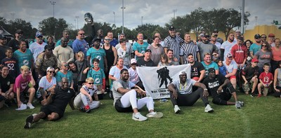 NFL stars and wounded warriors pose for WWP flag football event