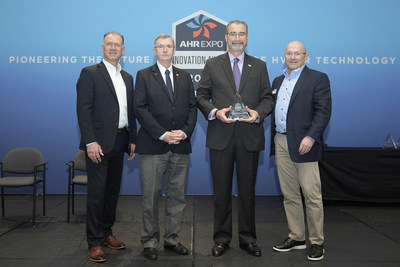 Senior vice president and general manager, Kevin McNamara (center right), accepts the 2020 AHR Innovation Award for the LG Hydro Kit, on behalf of LG Air Conditioning Technologies. The LG Hydro Kit is an indoor heat exchanger for LG Variable Refrigerant Flow (VRF) systems capable of transferring heat or cooling energy expelled from the air conditioning process to water, further capitalizing on the efficiency of LG heat recovery and heat pump systems.