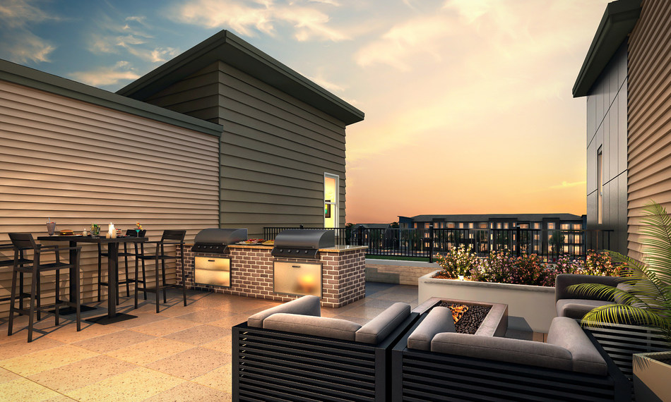 Rooftop patio and kitchen at 400 Littleton Village, by Century Communities