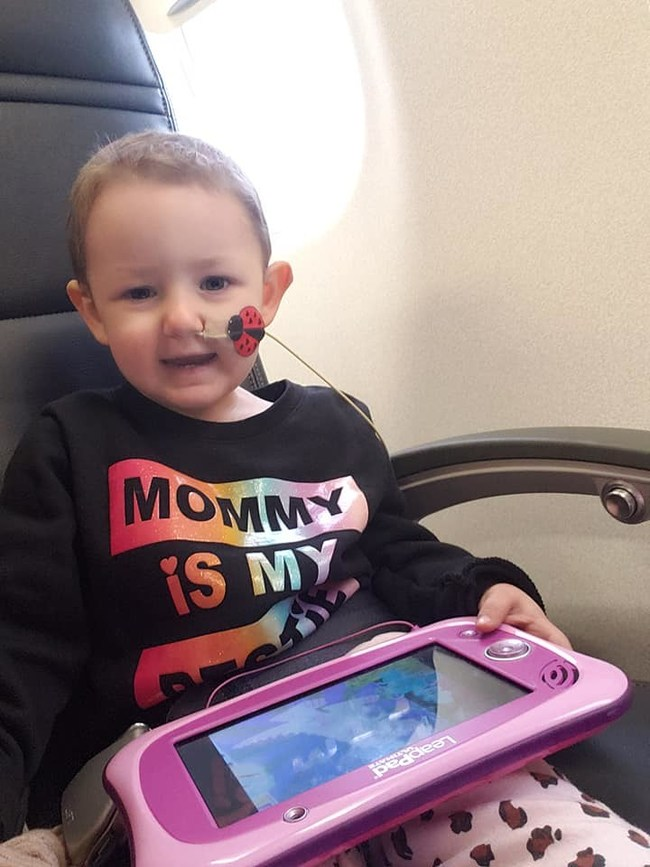 Two-year-old Joanna Hoskins of Great Falls, Montana, smiles on a recent Miracle Flight to Seattle Children's Hospital. Snow has made it too dangerous for Jojo's family to reach her chemotherapy treatments by car, so Miracle Flights is flying the family there free of charge. As the nation's leading medical flight charity, Miracle Flights provides hundreds of free plane tickets each month to help patients and their families reach specialty medical care not available in their local communities.
