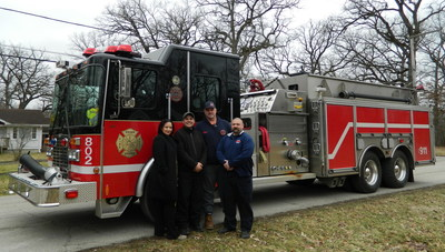 The Steger Estates (IL) Fire Department had been filling the Saleh family's temporary water holding tanks for almost a year before the family received a new water well from the Water Well Trust and the Groundwater Foundation. L to R: Marvet Saleh, Khaleel Saleh, SEFD engineer Bill Wheeler, and SEFD firefighter/paramedic Chris Ramirez.