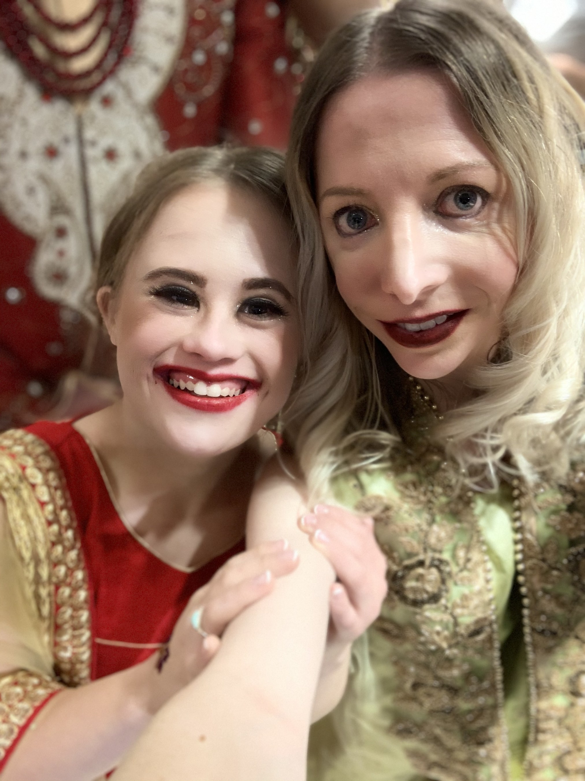 Cynthia Murphy, Treacher Collins Syndrome and Abigail Adams the Advocate with Down syndrome walking the runway together