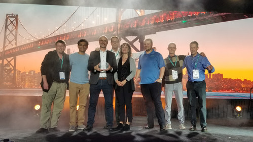 OSI president, Gregory Mader, accepts award with OSI staff and OSI clients, IBM and HomePro.