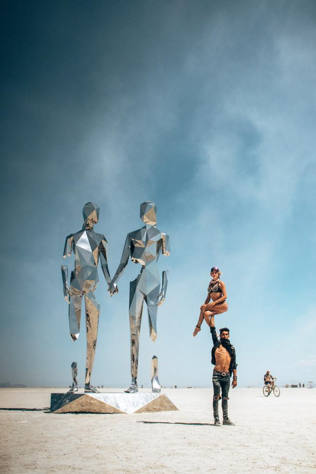 Rikki and Julia doing acrobatics at Burning Man