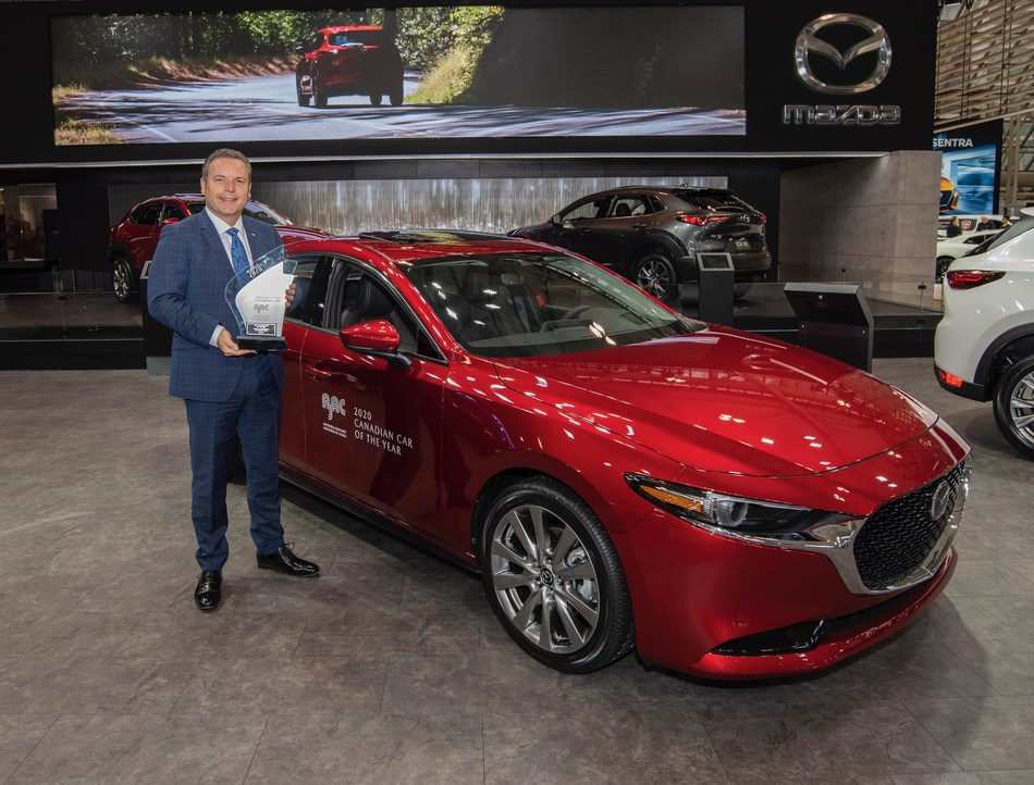 David Klan, President & CEO, Mazda Canada holding the trophy for the 2020 AJAC Canadian Car of the Year in front of the award-winning Mazda3 (CNW Group/Mazda Canada Inc.)