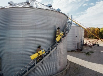 Firefighters respond to a grain bin engulfment.