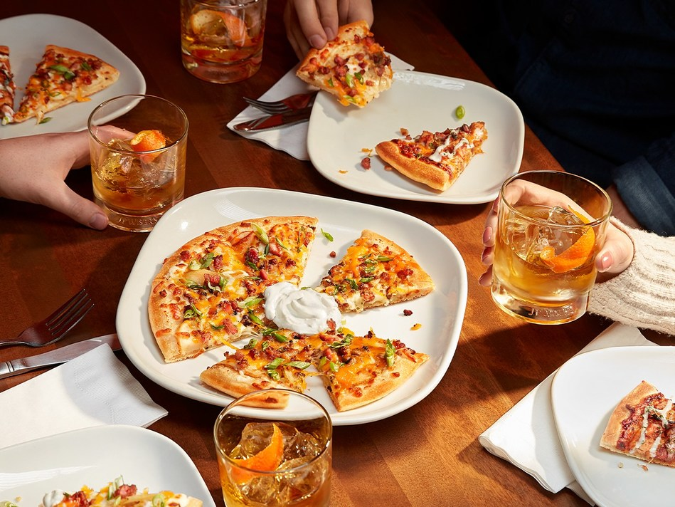 J.P. Wiser's wants Canadians to use the gift of time to come together with friends this Leap Day at Boston Pizza. (CNW Group/J.P. Wiser's)