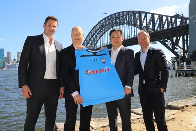Representatives from AETOS Capital Group and Sydney FC co-present the new season team Jersey.