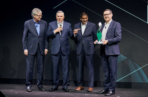 Daimler executives Martin Daum (left) and Marcus Schoenenberg (right) present the Daimler Supplier Award to Meritor's Jay Craig, CEO and president (second from left) and Chris Villavarayan, executive vice president and chief operating officer.